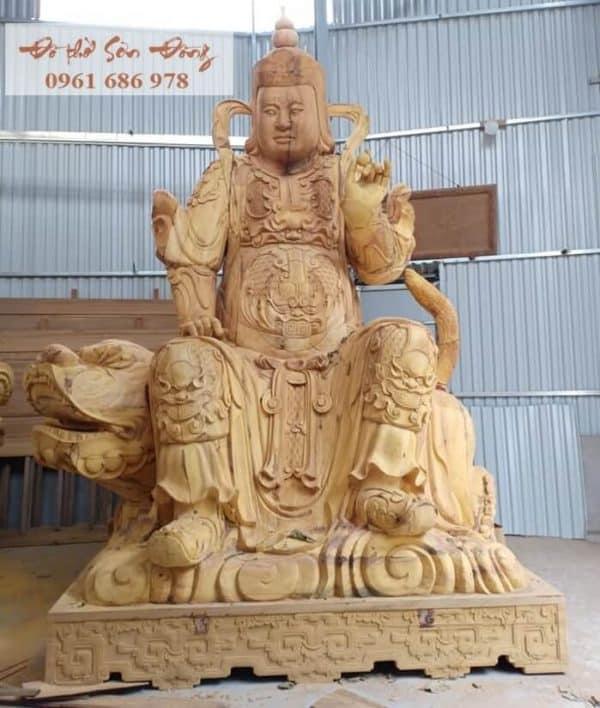 Tượng hộ pháp cưỡi kỳ lân bằng gỗ mít